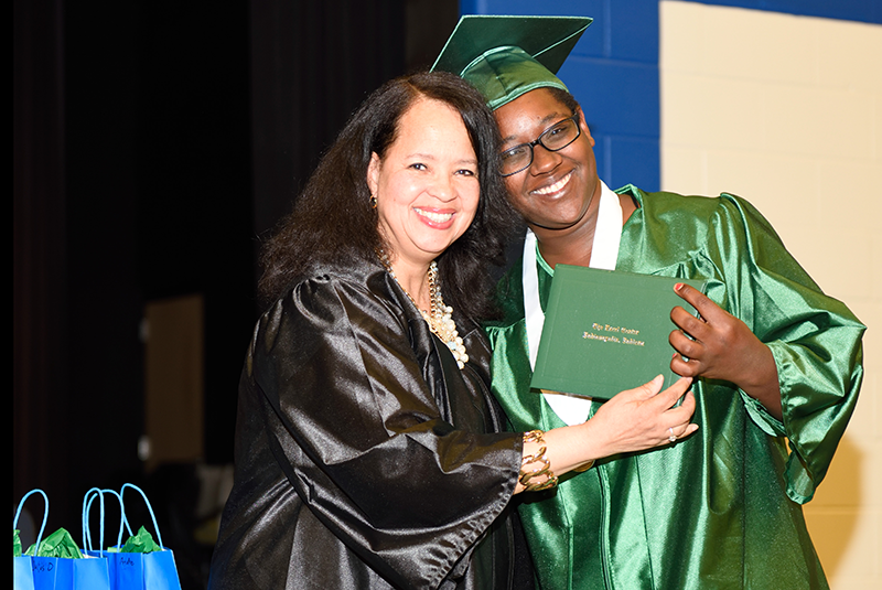 It took a round trip of four hours every school day to finish her high school diploma