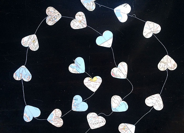 Easy DIY Garland sewing heart cut-outs in a strand