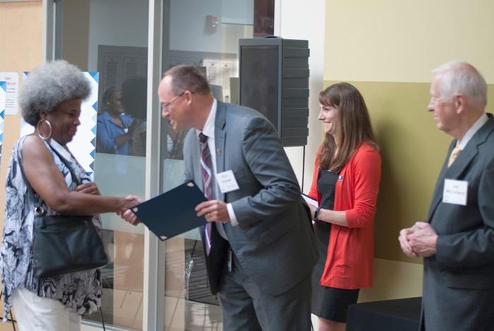 Ella receiving the McClelland Scholarship from Kent Kramer