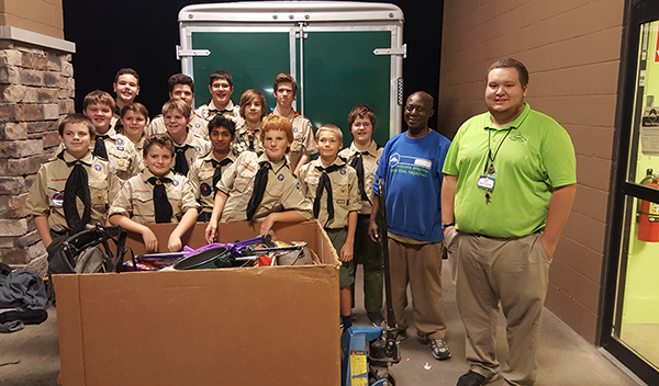 Boy Scouts Troop 199 showing off donations collected during their Good Turn for Goodwill drive