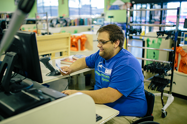 Goodwill disability services modified the cash register station to fit Matt's need