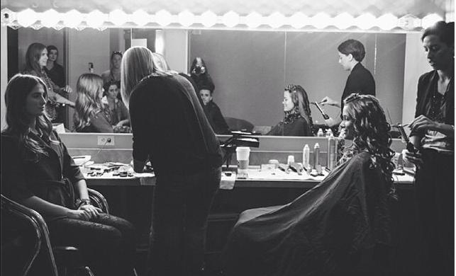 Natasha works on the set of a photoshoot