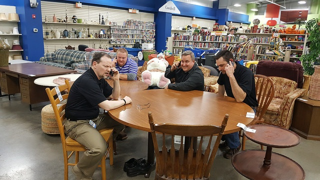 The Goodwill IT team problem solving technology left and right