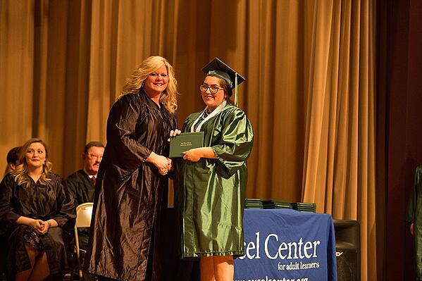 Novah graduates, setting the example for her son