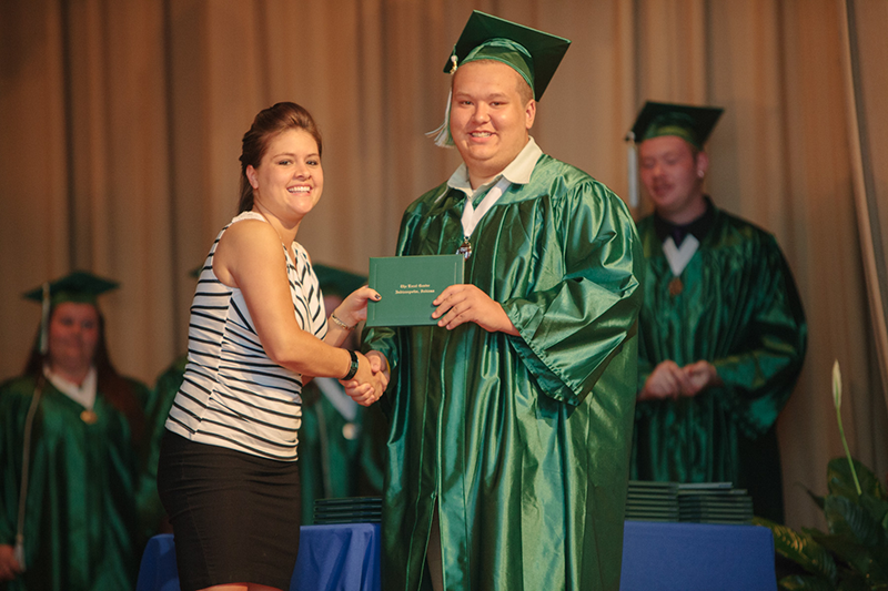 Dylan graduating from The Excel Center
